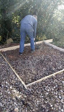 Levelling the fuel tank base area with gravel