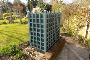 A bunded oil tank installed in Hampshire with lattice surround